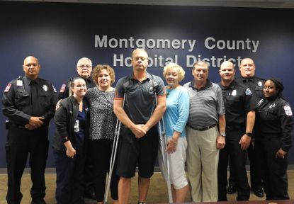 """Orioles scout Thom Dreier participates in a """"save ceremony"""" with the first responders who helped save his life in the Montgomery County (Texas) Hospital District."""