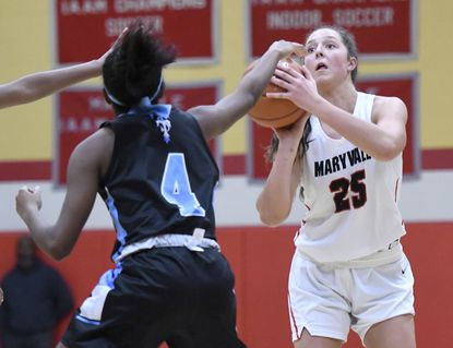 Maryvale's Claire Neff, right, shoots against Jada Johnson, of St. Timothy's, in the second half of a high school girls basketball game.