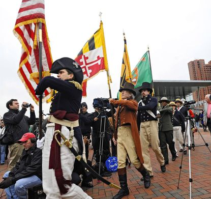 Fort McHenry Guards marched in the colors at the beginning of the ceremony to announce the Star-Spangled Sailabration.