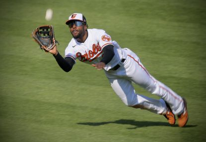 Baltimore's center fielder Cedric Mullins dives for the ball, robbing Boston's batter Bobby Dalbec in the fourth inning of the Opening Day game at Camden Yards.