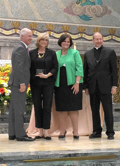 Archbishop Spalding principal Amy Cannon receives the Archdiocese of Baltimore's Excellence in Teaching Award in 2017. From left: Chancellor of Education, Archdiocese of Baltimore James Sellinger, Cannon, Superintendent, Archdiocese of Baltimore Barbara Edmondson, Archbishop William E. Lori. The school announced Thursday it had fired Cannon.
