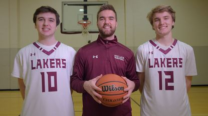 From left, the Spencer brothers Will, Pat and Cameron pose before a basketball game at Boys' Latin. Cameron is a senior guard, Will is a sophomore reserve and Pat is an assistant coach for the No. 1 ranked Lakers.