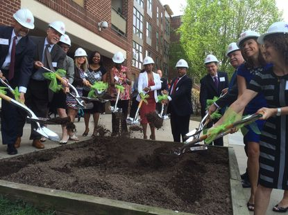 Officials host a ceremonial groundbreaking for an $11 million renovation to the Hollins House affordable apartment complex, expected to be finished in March 2017.