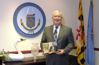Harford County Executive David Craig holds a book that staff members presented to him detailing accomplishments of his nine and a half year administration. Craig's last day of work for the county was Wednesday and, with his term ending Monday, he will join Gov.-elect Larry Hogan's transition team.