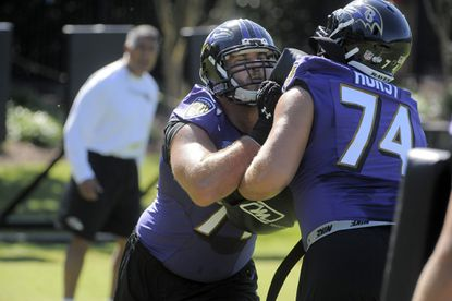 After a successful first season as a starter, Rick Wagner (left) hopes to be back in the lineup when the Ravens open the 2015 season.