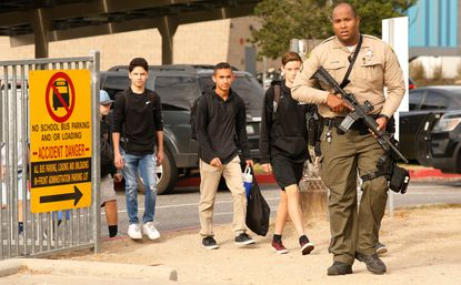 Students were escorted by police from Saugus High School on Nov. 14, 2019 after at least three people were wounded and two killed in a shooting when a gunman opened fire on the Santa Clarita, Calif., campus early Thursday.