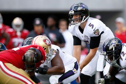 Ravens quarterback Joe Flacco goes under center against the San Francisco 49ers. Some say the offense's slow pace of play has hurt the team this season.