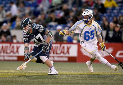Bayhawks' face-off man Charlie Raffa, left, scoops up the ball away from the Launch's Chris Mattes in the first quarter of a Major League Lacrosse game between the Chesapeake Bayhawks and Florida on April 30, 2016, at Navy-Marine Corps Memorial Stadium.