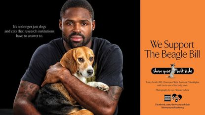 Torrey Smith holds a beagle in a Show Your Soft Side ad.
