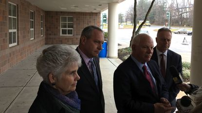 County Council members Mary Kay Sigaty and Jon Weinstein with Sen. Ben Cardin and Superintendent Michael Martirano speak following a discussion with Wilde Lake High School students about school safety and gun control.