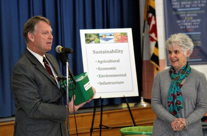 County Executive Allan Kittleman, left, talks about food scrap composting as Council Chair Mary Kay Sigaty looks on.