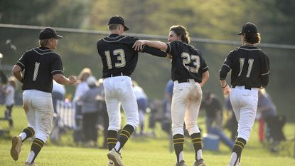 Century teammates, from left, Nathanael Hibbs, Jeremy Lapp, Zach Raico and Tyler Roach trot off the field at the conclusion of the Knights' 11-1 win over Westminster in Eldersburg Thursday, April 27, 2017.