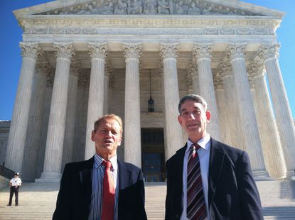 Maryland residents Stephen Shapiro, right, and John Benisek stand in front of the Supreme Court in Washington.