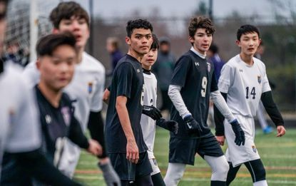 River Hill and Long Reach JV boys soccer players line up for a free kick during a game on March 16.