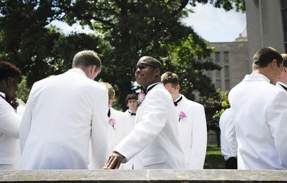 Omari Swift and the other members of the Class of 2012 at Mt. St. Joseph High School wait outside the Cathedral of Mary Our Queen in Baltimore for their graduation ceremony to begin June 3.