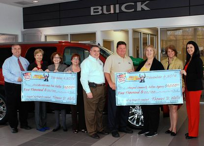 Members of the Bel Air New Car Dealers Association present representatives from the FCCAU Welcome One Shelter and Harford Community Action Agency this week's with $5,000 each. Pictured at the official ceremony at Boyle Buick GMC Truck on Tuesday are, from left, Bob Tolson, Heritage Auto Mall; Libby Copes, member, FCCAU Welcome One Emergency Shelter Board of Directors; Susan Moscareillo, executive director of FCCAU Welcome One Emergency Shelter; Barbara Jones, case manager for FCCAU Welcome One Emergency Shelter; Charles Walls, vice president of Plaza Ford; Chris Boyle, vice president of Boyle Buick-GMC Truck; Judith Mason, executive director of Harford Community Action Agency; Meg Deem, board president of Harford Community Action Agency; and Paige Boyle, vice president of Boyle Buick-GMC