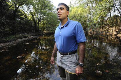 Sujay Kaushal, University of Maryland geologist, wades in the Gwynns Falls.