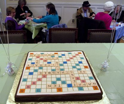 A cake that looked like a Scrabble board was served during the 10th anniversary fundraising event in 2011 at Calvert School. The 12th annual benefit is April 6 at Roland Park Country School.