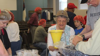 Bonnie Titus (left to right), Carol Simmons, and Paul Shaffer were among the folks who packed more than 10,000 meals at Glen Burnie United Methodist Church for Rise Against Hunger.