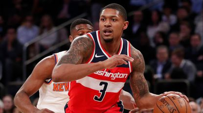 Washington Wizards guard Bradley Beal (3) drives toward the basket in the first half against the Knicks on Wednesday night in New York.