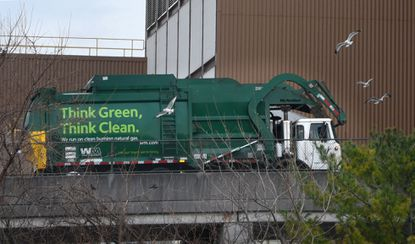 A garbage truck waits to enter the Wheelabrator Baltimore incinerator in Westport. The incinerator processes up to 2,250 tons of post-recycled waste daily.