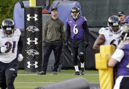 Ravens head coach John Harbaugh, left, and wide receiver Keenan Reynolds watch a drill during an NFL football rookie minicamp at the team's practice facility in Owings Mills, Md., Saturday, May 7, 2016.