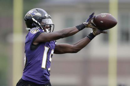 "Ravens wide receiver Marquise ""Hollywood"" Brown makes a catch during training camp,"