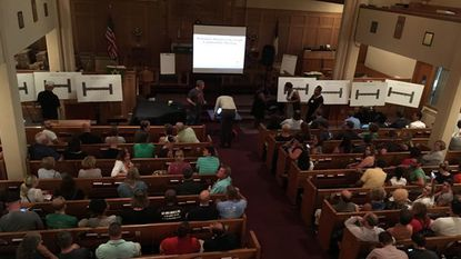 Residents packed a meeting about a new design for a protected bike lane in Canton.