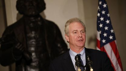 "Sen. Chris Van Hollen (D-MD), shown speaking at an event honoring the bicentennial of Frederick Douglass' birth, says he has consistently fought for funding for the Community Service Block Grant, which helps HSP of Carroll COunty to ""fight poverty at a local level."""