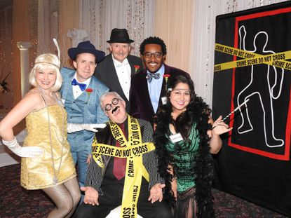 """Participants from a production of Sinister Speakeasy surround the """"body."""" From left, Tanya Davis, Ben Fisler, Leonard Gilbert, Jon Evans and Jess Rivera."""