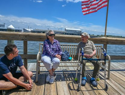 Retirees Carmela and Robert Singer enjoy lunch in the sunshine on the Crisfield City Dock with their grandson John Boncore, 19, a student at the University of Maryland, Baltimore County. (Jerry Jackson/Baltimore Sun).