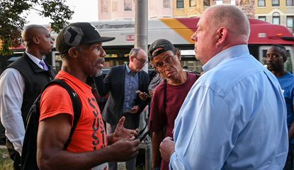While at a boxing gym on North Ave., Gov. Larry Hogan announced that he has called on Attorney General Frosh to prosecute more cases in Baltimore. Afterwards, Gov. Hogan met with community members to answer questions, he's seen here with Glenn Wooden and Benny Sheridan, both of Baltimore.