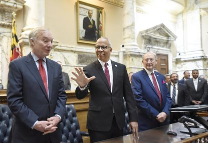 From left, Maryland Comptroller Peter Franchot, Maryland Lt. Gov. Boyd Rutherford and Maryland Secretary of State John C. Wobensmith stand in front of a joint session of the legislature before Maryland Gov. Larry Hogan, not pictured, delivers his annual State of the State address in Annapolis earlier this month.