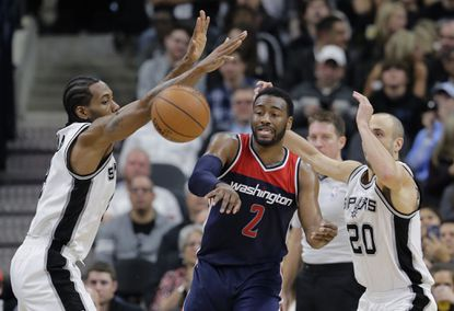 Spurs beat Wizards for team-record 23rd straight home win