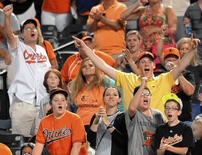 Orioles fans cheer in game in which the Orioles defeated Tampa Bay Rays by the score of 4 to 2 at Oriole Park at Camden Yards.