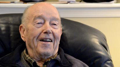 Charles Irwin of Bel Air is shown reminiscing about a Baltimore Sunpapers Chirstmas radio program he sang on while stationed with the Army in Europe in 1943. Mr. Irwin died Thursday at age 100.