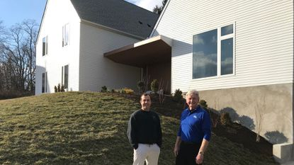 New Points sober living community executive director Warrie Boyd and founder Tom Burden stand outside the first of the five homes that will open in late March or early April.