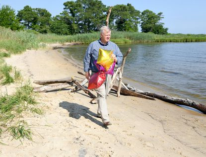 Jay Falstad, Executive Director of the Queen Anne's Conservation Association, is backing a bill to make balloon releases illegal in Queen Anne's County and shows some balloons he has recently found on the Chester River.
