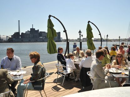 The deck at Waterfront Kitchen, with its sweeping Inner Harbor views.