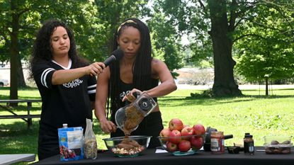 Left to right, Apeh Clary, Vallejo, CA, manager, and Carrie Dewberry, Durham, NC, So Freakin' Vegan Instagram and Youtuber, give a food demonstration at the Keep It Fresh Fest and African Griot Book Fair, hosted by the Black Vegetarian Society of Maryland, in Baltimore.