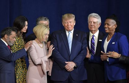 President Donald J. Trump is surrounded and prayed for during a Evangelicals for Trump rally at King Jesus International Ministry earlier this month.