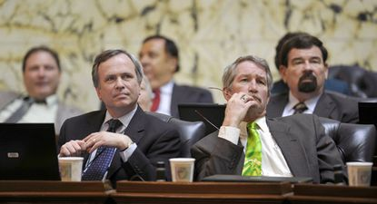 Del. Stephen W. Lafferty, right, listens to debate on the House floor in Annapolis last year with Del. Dana M. Stein.
