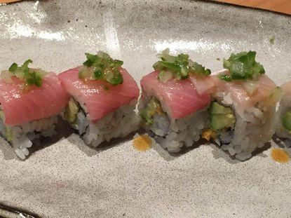 A maki roll at Azumi wiht avocado, nori(seaweed) and tempura flakes, topped with hamachi, and jalapeno relish.