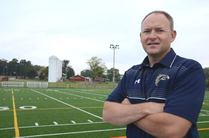 Dave Lanham, athletic director for Severna Park High School, stands at the new artificial turf fields at Kinder Farm Park in Millersville. Some Severna Park High School sports teams will use the fields while their school is under construction. the fields also will be used by the Green Hornets youth organization. Photo by Pamela Wood/staff