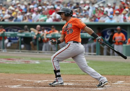 Baltimore Orioles' Garabez Rosa follows through on a swing against the Boston Red Sox in a spring training baseball game, Monday, March 28, 2016, in Fort Myers, Fla.