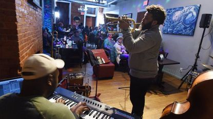 Many African American owned restaurants in Baltimore, like Terra Cafe in lower Charles Village, serve as an eatery and a community gathering spot for its patrons. Every Monday there's a jazz night and open mic session at the cafe.