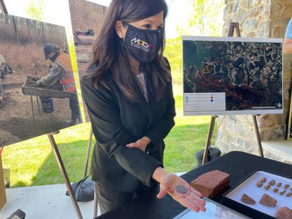 Julie Schablitsky, chief archaeologist with the State Highway Administration, displays a coin from 1808 that was discovered on the site of Harriet Tubman's father's former home.