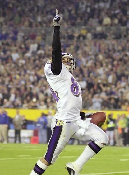 Jermaine Lewis points to the sky as he runs back a kickoff for a touchdown during the Super Bowl in 2001.