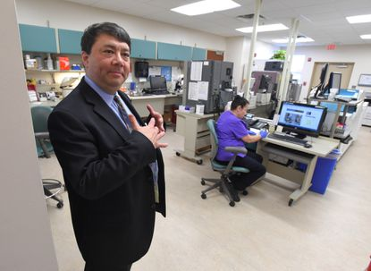 Mark Arsenault, vice president for the Bowie Health Campus, is pictured in the Lab Annex.