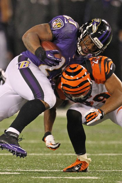 Ravens running back Ray Rice picks up a few yards against the Bengals in the season opener.